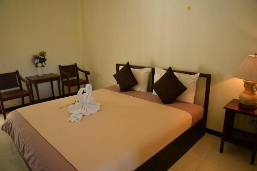 A bed or beds in a room at Rimtarn Resort