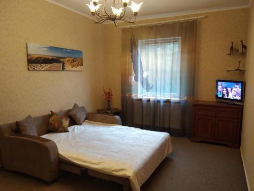 Кровать или кровати в номере Двухкомнатные апартаменты