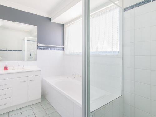 A bathroom at 1/54 Parkes, Airconditioned