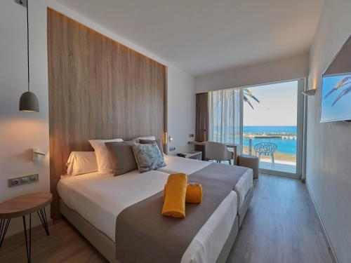 A bed or beds in a room at BQ Aguamarina Boutique Hotel