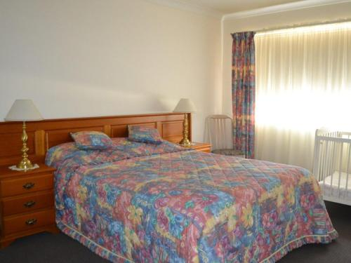 A bed or beds in a room at Bowling Greens 7