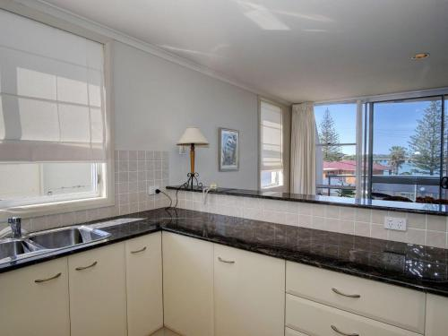 A kitchen or kitchenette at Castillo Del Mar 11 Overlooking Wallis Lake