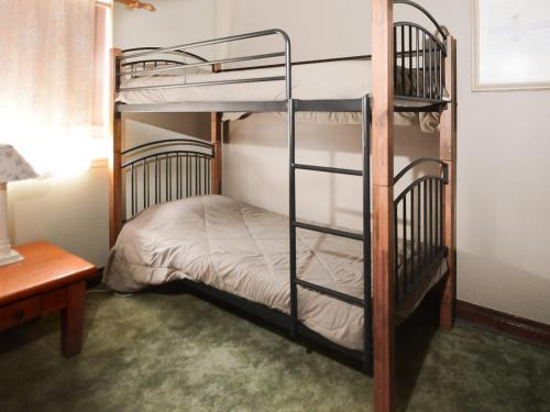 A bunk bed or bunk beds in a room at Debra Court 6