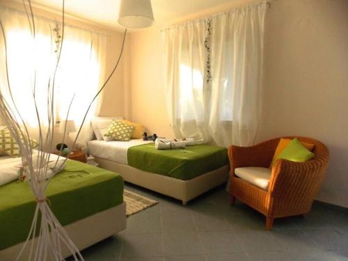 Ένα ή περισσότερα κρεβάτια σε δωμάτιο στο Filippos Resort II by Karidi