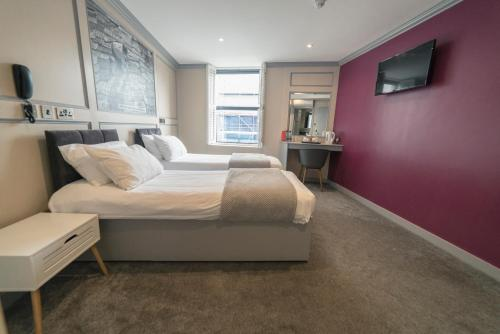 A bed or beds in a room at Central Station Hotel Liverpool