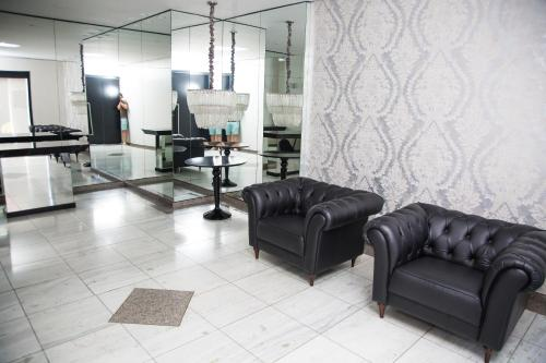 A seating area at GuestHouse CHAI Joinville (N.02)