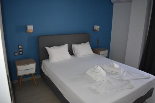 Ένα ή περισσότερα κρεβάτια σε δωμάτιο στο Christina Studios & Apartments
