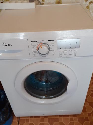 A kitchen or kitchenette at Апартаменты посуточно на любой срок.