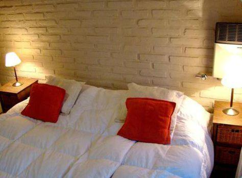 A bed or beds in a room at Rincon del Sur