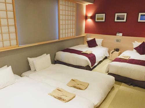 ベストウェスタンプラスホテルフィーノ千歳にあるベッド