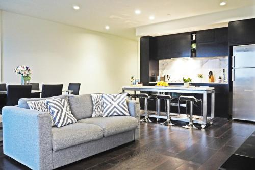 A seating area at STYLISH 2BR 2BTH + CAR = HEART OF SOUTH YARRA