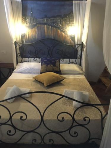 Letto o letti in una camera di B&B Ginevra