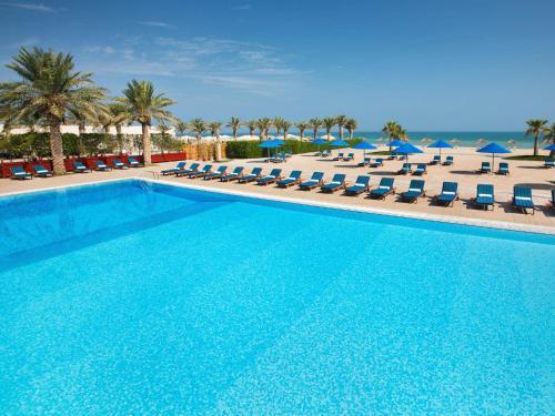 The swimming pool at or near Hilton Kuwait Resort
