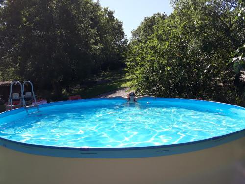 The swimming pool at or near Chambres & Tables d'hôtes Le Pech Grand