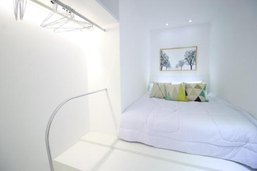 A bed or beds in a room at Flat Metropolitan Smart Style