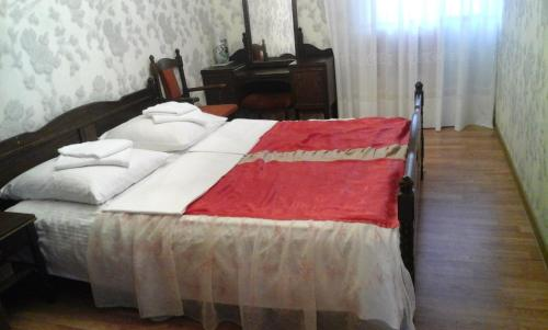 A bed or beds in a room at Apartment for Family and Companies