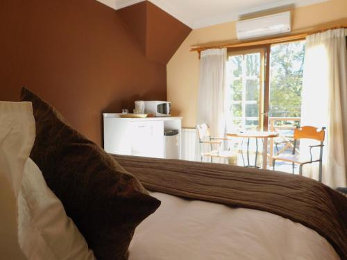 Cama o camas de una habitación en Velvet375 GAY Hotel, Hetero-Friendly