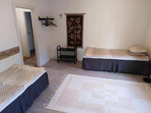 Vuode tai vuoteita majoituspaikassa FirstHome GuestHouse