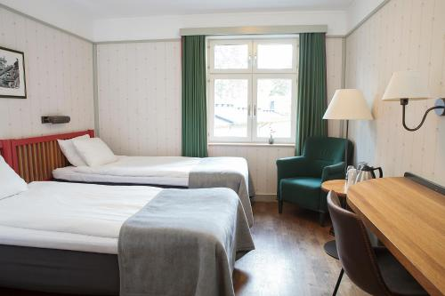 A bed or beds in a room at STF Hotel Zinkensdamm