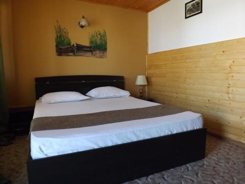 A bed or beds in a room at Casa Mister