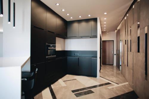 A kitchen or kitchenette at BonApartments