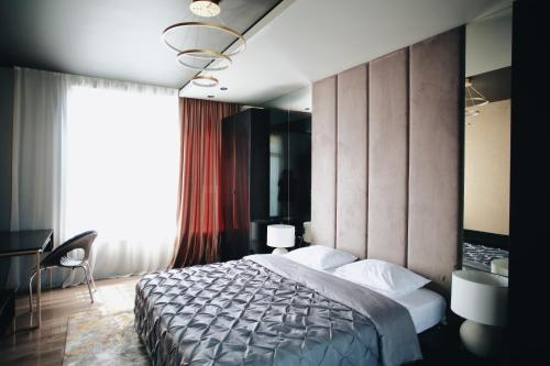 A bed or beds in a room at BonApartments