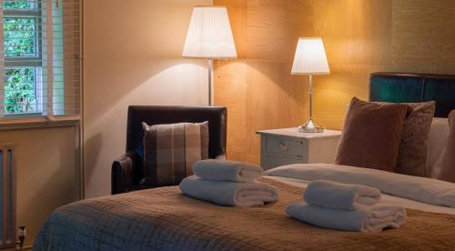 A bed or beds in a room at The Mulberry Inn