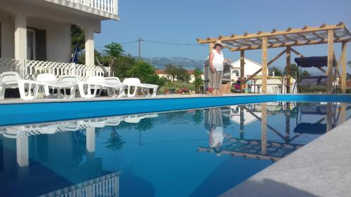 The swimming pool at or near Apartmani Milica
