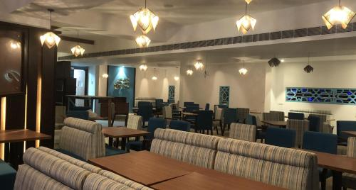 A restaurant or other place to eat at Elegant Serviced Apartment