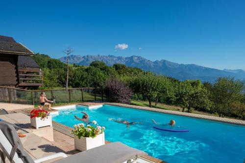 The swimming pool at or near Chalets du Vieux Frêne