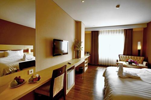 A television and/or entertainment center at Hotel California Bandung