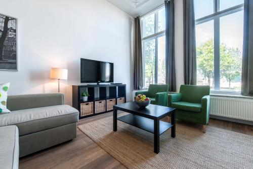 Een zitgedeelte bij Short Stay Group Harbour Apartments Amsterdam