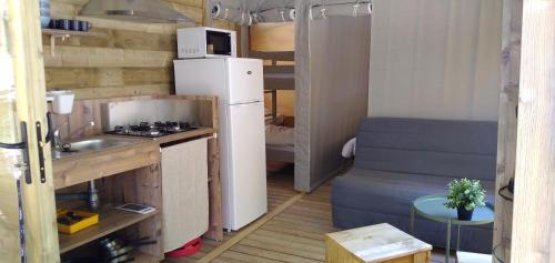 A kitchen or kitchenette at Camping la Grangeonne