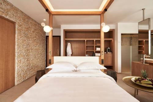 A bed or beds in a room at Myconian Naia - Preferred Hotels & Resorts