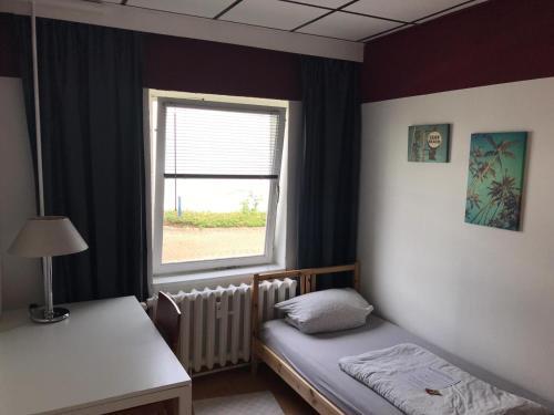 Ein Bett oder Betten in einem Zimmer der Unterkunft Backpackers Inn Rostock