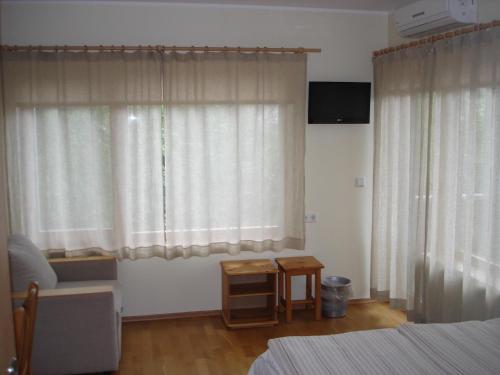 Televiisor ja/või meelelahutuskeskus majutusasutuses Aisa Accommodation