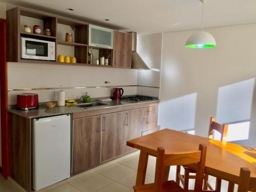 Una cocina o kitchenette en Andino Aparts - El Chaltén