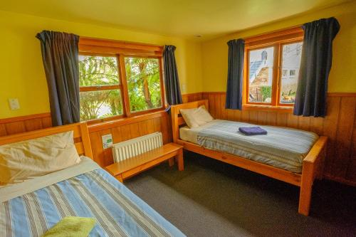 A bed or beds in a room at The Old Countryhouse