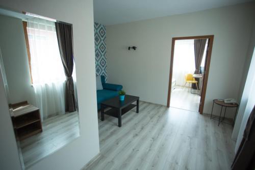 Ein Sitzbereich in der Unterkunft Atlant Hotel