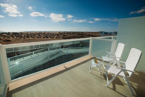 A balcony or terrace at Hotel Boutique TAO Caleta Mar