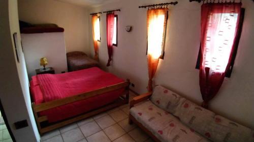 Letto o letti in una camera di Agriturismo Rio Lovaira