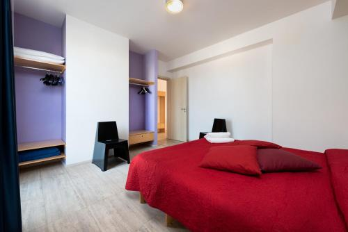 A bed or beds in a room at Vitorno Residence
