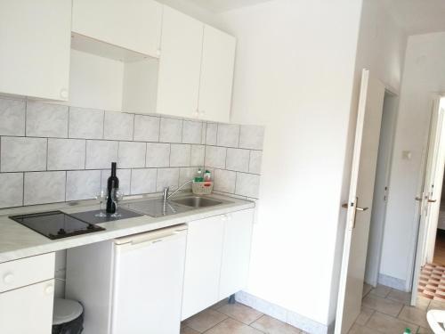 A kitchen or kitchenette at Apartments Kati