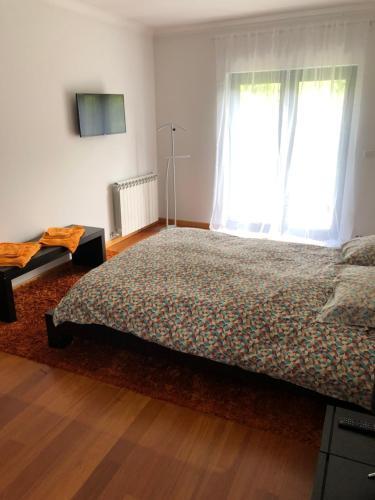 A bed or beds in a room at Quinta Vale da Aldeia - Penalva do Castelo
