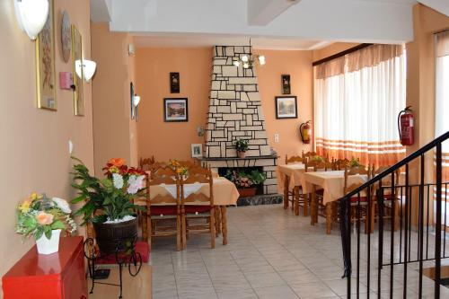 A restaurant or other place to eat at Hotel Perama