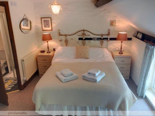 A bed or beds in a room at Powys Country House