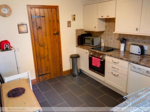 A kitchen or kitchenette at Powys Country House