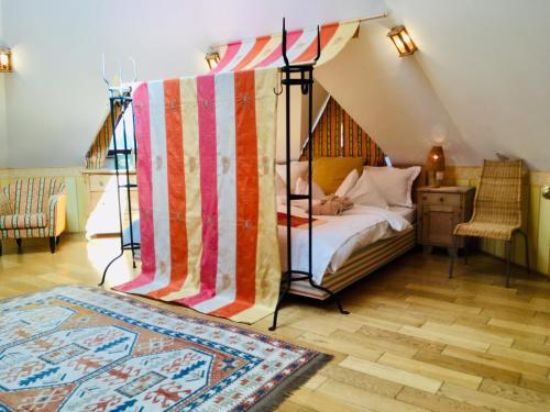 A bed or beds in a room at Das Römerstein - die pure WohlFühlOase