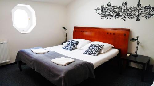 Postel nebo postele na pokoji v ubytování Mai Bohemia Hostel and Apartment