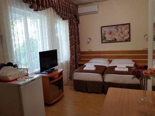 Кровать или кровати в номере Астон Отель Джемете